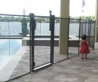 child being guarded by a swimming pool safety device in Oldsmar fl